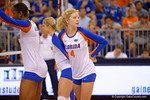 Florida Gators Volleyball player Carli Snyder looks back to the Gator server before the serve.  Florida Gators Volleyball vs Mississippi State Bulldogs.  October 26th, 2014. Gator Country photo by David Bowie.