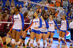 The Florida Gators shake hands at the net with the Mississippi State Bulldogs prior to the start of the match.  Florida Gators Volleyball vs Mississippi State Bulldogs.  October 26th, 2014. Gator Country photo by David Bowie.
