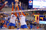 Florida Gators Volleyball player Rhamat Alhassan and Ziva Recek leap up to attempt a block during the first set.  Florida Gators Volleyball vs Mississippi State Bulldogs.  October 26th, 2014. Gator Country photo by David Bowie.