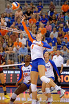 Florida Gators Volleyball player Ziva Recek tips a ball over the net during the first set.  Florida Gators Volleyball vs Mississippi State Bulldogs.  October 26th, 2014. Gator Country photo by David Bowie.