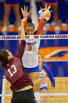 Florida Gators Volleyball player Alex Holston with the block on Mississippi State's Chelsea Duhs during the third set in the match.  Florida Gators Volleyball vs Mississippi State Bulldogs.  October 26th, 2014. Gator Country photo by David Bowie.