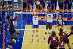 Florida Gators Volleyball player Mackenzie Dagostino and Simone Antwi attempt the block on the hit by Mississippi State's Alex Warren during the third set in the match.  Florida Gators Volleyball vs Mississippi State Bulldogs.  October 26th, 2014. Gator Country photo by David Bowie.