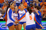 The Florida Gators volleyball team gather after scoring a point during the first set.  Florida Gators Volleyball vs Mississippi State Bulldogs.  October 26th, 2014. Gator Country photo by David Bowie.