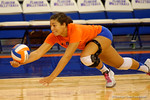 Florida Gators Volleyball player Noami Santos-Lamb dives for a ball during pre-game warm ups. Florida Gators Volleyball vs Mississippi State Bulldogs.  October 26th, 2014. Gator Country photo by David Bowie.
