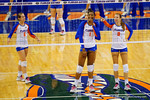 Florida Gators Volleyball player Rhamat Alhassan and Ziva Recek point at the jumbotron and laugh.  Florida Gators Volleyball vs Mississippi State Bulldogs.  October 26th, 2014. Gator Country photo by David Bowie.