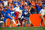Florida Gators quarterback Treon Harris rushes into the endzone as Gators wide receiver holds onto a USC defender drawing the penalty and voiding the touchdown.  Florida Gators vs South Carolina Gamecocks.  November 14th, 2014. Gator Country photo by David Bowie.