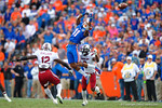 Florida Gators wide receiver Demarcus Robinson leaps into the air attempting a catch during the third quarter.  Florida Gators vs South Carolina Gamecocks.  November 14th, 2014. Gator Country photo by David Bowie.