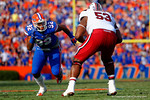 Florida Gators defensive end Gerald Willis rushes off the  line attempting to get around USC Gamecocks lineman Corey Robinson during the fourth quarter.  Florida Gators vs South Carolina Gamecocks.  November 14th, 2014. Gator Country photo by David Bowie.