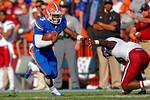 Florida Gators quarterback Treon Harris rushes downfield during the fourth quarter.  Florida Gators vs South Carolina Gamecocks.  November 14th, 2014. Gator Country photo by David Bowie.