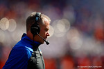 Florida Gators defensive coordinator D.J. Durkin talks off the field following a timeout talk with his team.  Florida Gators vs South Carolina Gamecocks.  November 14th, 2014. Gator Country photo by David Bowie.