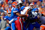 Florida Gators defensive lineman Dante Fowler, Jr. and Florida Gators defensive back Marcus Maye combine for the tackle on USC Gamecocks tailback Brandon Wilds during the first quarter.  Florida Gators vs South Carolina Gamecocks.  November 14th, 2014. Gator Country photo by David Bowie.