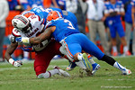 Florida Gators Jalen Tabor and Antonio Morrison combine for a tackle on USC Gamecocks tight end Jerell Adams during the third quarter.  Florida Gators vs South Carolina Gamecocks.  November 14th, 2014. Gator Country photo by David Bowie.