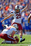 USC Gamecocks kicker Elliott Fry kicks in the field goal to extend the Gamecocks lead over the Gators to 10-0 in the first quarter.  Florida Gators vs South Carolina Gamecocks.  November 14th, 2014. Gator Country photo by David Bowie.