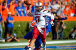 USC quarterback Dylan Thompson throws from the endzone being chased during the second quarter.  Florida Gators vs South Carolina Gamecocks.  November 14th, 2014. Gator Country photo by David Bowie.