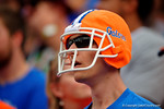 A Florida Gators fan watches on wearing his own helmet during the third quarter.  Florida Gators vs South Carolina Gamecocks.  November 14th, 2014. Gator Country photo by David Bowie.