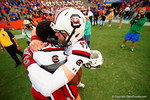USC quarterback Dylan Thompson and defensive tackle J.T. Surratt celebrate their overtime win over the Gators.  Florida Gators vs South Carolina Gamecocks.  November 14th, 2014. Gator Country photo by David Bowie.