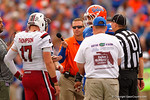 Florida Gators offensive lineman Max Garcia and USC quarterback Dylan Thompson meet at midfield for the coin toss for overtime.  Florida Gators vs South Carolina Gamecocks.  November 14th, 2014. Gator Country photo by David Bowie.