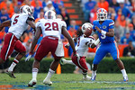 Florida Gators quarterback Treon Harris looks downfield for an open receiver as the USC defense closes in.  Florida Gators vs South Carolina Gamecocks.  November 14th, 2014. Gator Country photo by David Bowie.