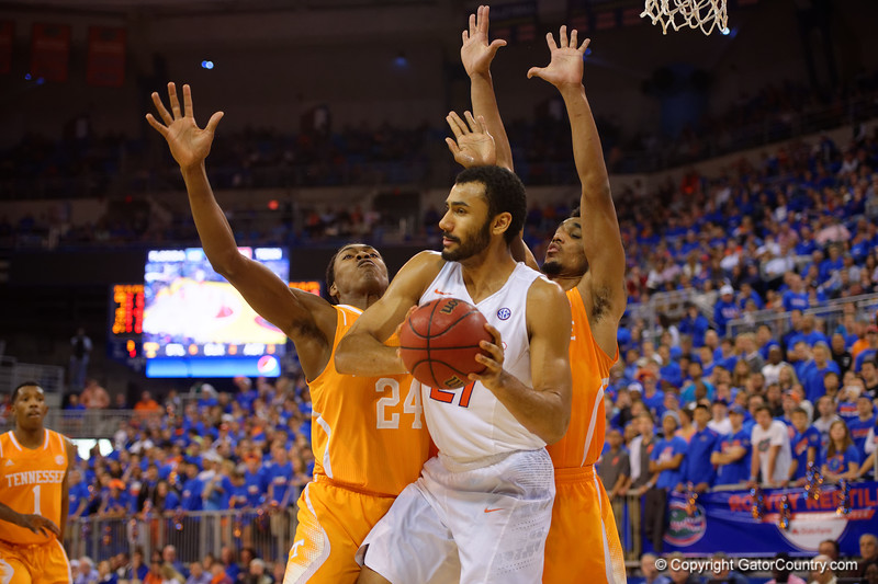 Florida Gators center Jon Horford gets the ball down low but is immediately double teamed by Tennessee Volunteers forward Willie Carmichael III and Tennessee Volunteers forward Armani Moore.  Florida Gators vs Tennessee Vols.  February 28th, 2015. Gator Country photo by David Bowie.