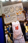 Florida Gators forward Dorian Finney-Smith holds up a sign made by one of the Gator fans commemorating Florida Gators head coach Billy Donovan's 500th win.  Florida Gators vs Tennessee Vols.  February 28th, 2015. Gator Country photo by David Bowie.