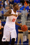 Florida Gators forward Dorian Finney-Smith dribbles up court during the second half.  Florida Gators vs Tennessee Vols.  February 28th, 2015. Gator Country photo by David Bowie.