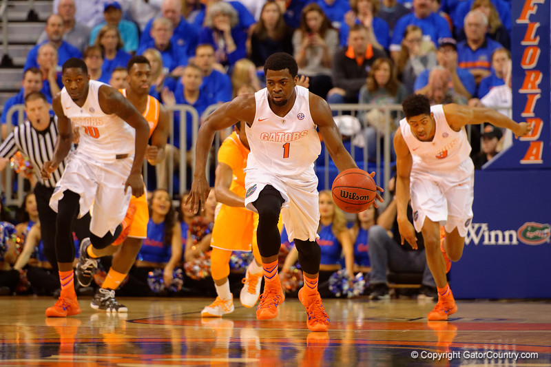 Florida Gators guard Eli Carter leads the Gators down court on a breakaway during the first half.  Florida Gators vs Tennessee Vols.  February 28th, 2015. Gator Country photo by David Bowie.