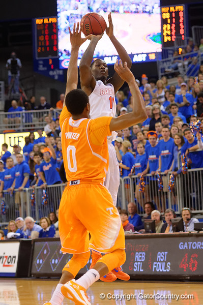 Florida Gators forward Dorian Finney-Smith drains a three pointer during the second half.  Florida Gators vs Tennessee Vols.  February 28th, 2015. Gator Country photo by David Bowie.