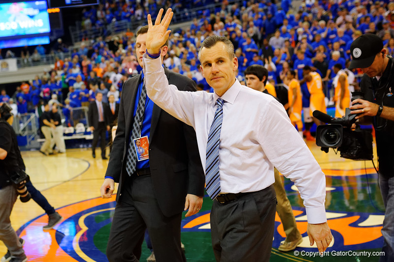 Florida Gators head coach Billy Donovan waves to the crowd as they cheer on his 500th victory.  Florida Gators vs Tennessee Vols.  February 28th, 2015. Gator Country photo by David Bowie.