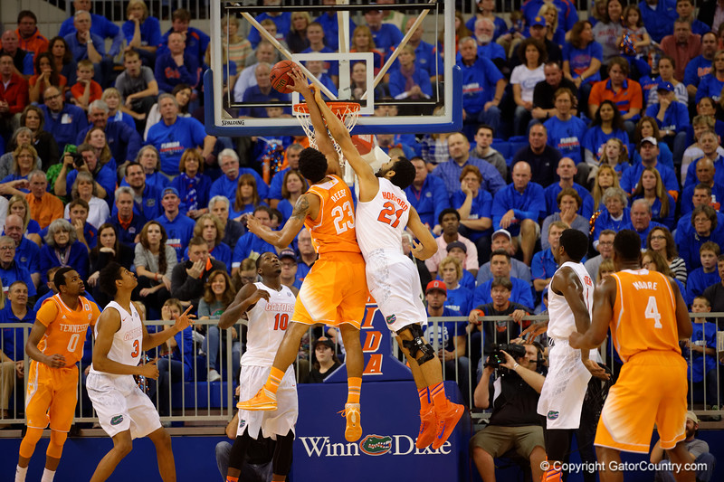 Florida Gators center Jon Horford fouls Tennessee Volunteers forward Derek Reese while trying to block the shot by Reese.  Florida Gators vs Tennessee Vols.  February 28th, 2015. Gator Country photo by David Bowie.