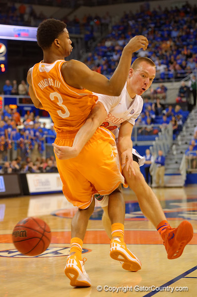 Florida Gators forward Jacob Kurtz passes around and draws the foul on Tennessee Volunteers guard Robert Hubbs III during the first half.  Florida Gators vs Tennessee Vols.  February 28th, 2015. Gator Country photo by David Bowie.