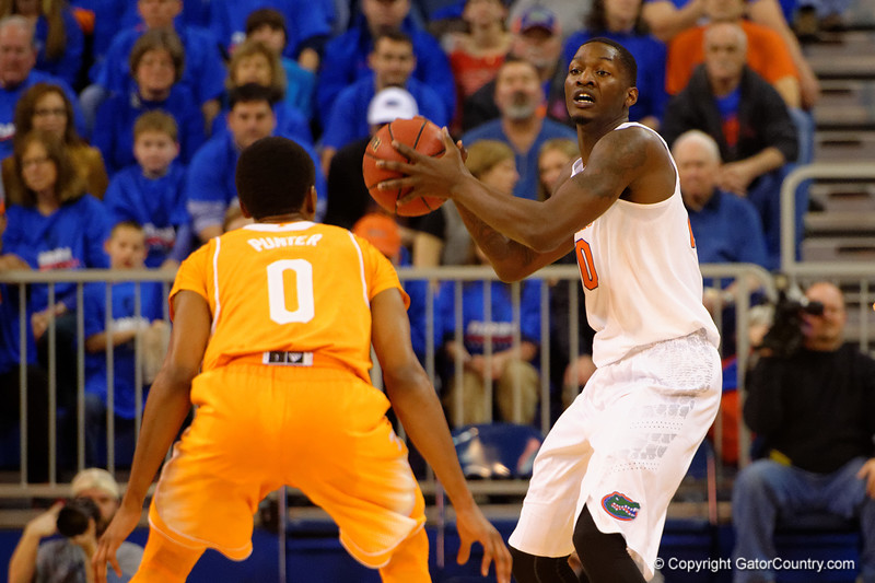 Florida Gators forward Dorian Finney-Smith looks topass down court during the first half while being guarded by Tennessee Volunteers guard Kevin Punter.  Florida Gators vs Tennessee Vols.  February 28th, 2015. Gator Country photo by David Bowie.
