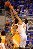 Florida Gators center Jon Horford and Tennessee Volunteers forward Armani Moore leap during the tip off.  Florida Gators vs Tennessee Vols.  February 28th, 2015. Gator Country photo by David Bowie.