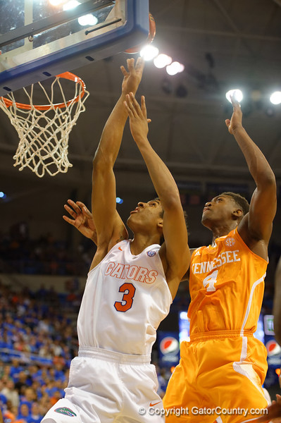 Florida Gators forward Devin Robinson and Tennessee Volunteers forward Armani Moore fight for a rebound during the first half.  Florida Gators vs Tennessee Vols.  February 28th, 2015. Gator Country photo by David Bowie.