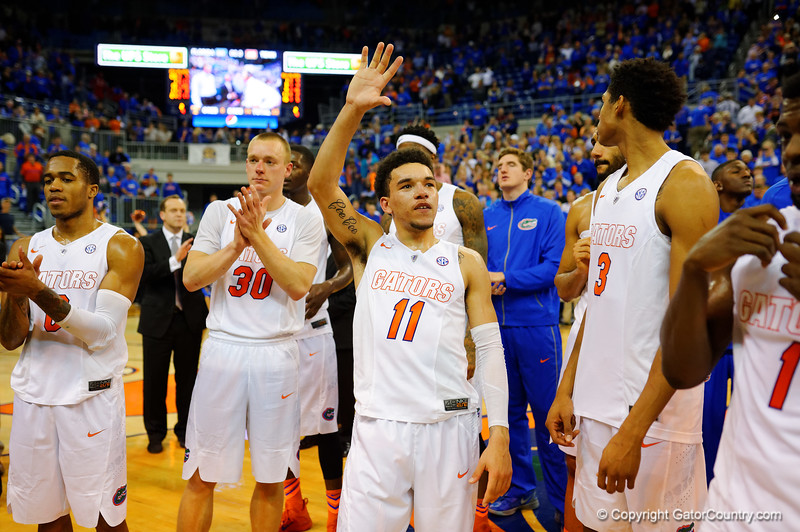 Florida Gators guard Chris Chiozza holds a five in the air to celebrate Florida Gators head coach Billy Donovan's 500th win.  Florida Gators vs Tennessee Vols.  February 28th, 2015. Gator Country photo by David Bowie.