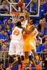 Tennessee Volunteers forward Armani Moore leaps for a rebound against Florida Gators forward Chris Walker, Florida Gators forward Devin Robinson, and Florida Gators guard Chris Chiozza.  Florida Gators vs Tennessee Vols.  February 28th, 2015. Gator Country photo by David Bowie.