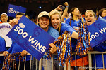 Florida Gator fans hold up signs to celebrate Florida Gators head coach Billy Donovan's 500th win.  Florida Gators vs Tennessee Vols.  February 28th, 2015. Gator Country photo by David Bowie.