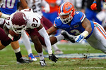Florida Gators linebacker Antonio Morrison lays out to tackle Eastern Kentucky DB Stanley AbsanonFlorida Gators vs Eastern Kentucky Colonels.  November 22th, 2014. Gator Country photo by David Bowie.