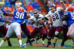EKU running back Dy'Shawn Mobley finds a hole and rushes up the gap during the frst quarter.  Florida Gators vs Eastern Kentucky Colonels.  November 22th, 2014. Gator Country photo by David Bowie.