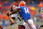 Eastern Kentucky quarterback Barton Mann is sacked by Florida Gators defensive end Alex McCalister in the third quarter.  Florida Gators vs Miami Hurricanes.  November 17th, 2014. Gator Country photo by David Bowie.