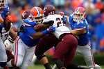 Florida Gators defensive lineman Jay-nard Bostwick explodes off the line to make the tackle on Eastern Kentucky running back Kentayvus Hopkins in the fourth quarter.  Florida Gators vs Miami Hurricanes.  November 17th, 2014. Gator Country photo by David Bowie.
