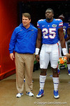 Florida Gators fullback Gideon Ajagbe is greeted by Florida Gators Head Coach Will Muschamp during senior day introductions.  Florida Gators vs Eastern Kentucky Colonels.  November 22th, 2014. Gator Country photo by David Bowie.