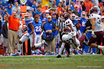 Florida Gators wide receiver Demarcus Robinson sprints downfield after making a reception in the thrid quarter.  Florida Gators vs Miami Hurricanes.  November 17th, 2014. Gator Country photo by David Bowie.