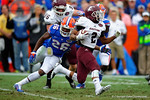 Eastern Kentucky running back Jared Sanders rushes upfield as Florida Gators defensive back Marcell Harris attempts the tackle.  Florida Gators vs Eastern Kentucky Colonels.  November 22th, 2014. Gator Country photo by David Bowie.