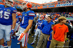 Florida Gators Head Coach Will Muschamp stands with one of his sons as he prepares for his last home game as Gators head coach.  Florida Gators vs Eastern Kentucky Colonels.  November 22th, 2014. Gator Country photo by David Bowie.