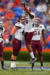EKU linebacker Chris Kelly and Theron Norman celebrate Kelly tackling Florida Gators quarterback Treon Harris in the first quarter.  Florida Gators vs Eastern Kentucky Colonels.  November 22th, 2014. Gator Country photo by David Bowie.