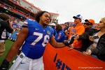 Florida Gators offensive lineman Max Garcia shakes hands with the fans as he heads off the field.  Florida Gators vs Eastern Kentucky Colonels.  November 22th, 2014. Gator Country photo by David Bowie.