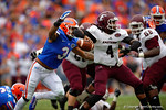 Florida Gators linebacker Antonio Morrison rushes around the outside to get to Eastern Kentucky quarterback Bennie Coney.  Florida Gators vs Eastern Kentucky Colonels.  November 22th, 2014. Gator Country photo by David Bowie.