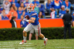Florida Gators  wide receiver Mike McNeely catches the ball in the flat and turns upfield during the fourth quarter.  Florida Gators vs Miami Hurricanes.  November 17th, 2014. Gator Country photo by David Bowie.