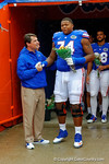 Florida Gators offensive lineman Trenton Brown is greeted by Florida Gators Head Coach Will Muschamp during senior day introductions.  Florida Gators vs Eastern Kentucky Colonels.  November 22th, 2014. Gator Country photo by David Bowie.