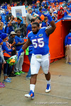 Florida Gators offensive lineman Roderick Johnson runs out onto the field during senior day introductions.  Florida Gators vs Eastern Kentucky Colonels.  November 22th, 2014. Gator Country photo by David Bowie.